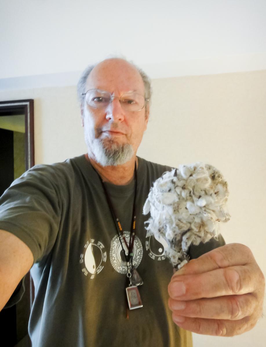 Ron holding dried white snow lotus herb